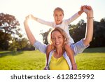 cheerful mother with daughter... | Shutterstock . vector #612825992