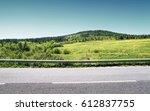 asphalt road and green hill...   Shutterstock . vector #612837755