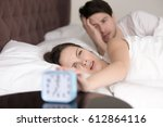 young sleepy man and woman... | Shutterstock . vector #612864116