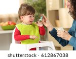 toddler crying at lunch time... | Shutterstock . vector #612867038