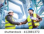oil refinery engineers... | Shutterstock . vector #612881372