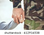 two hands  of one family  ... | Shutterstock . vector #612916538