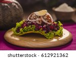 guatemalan enchilada over a... | Shutterstock . vector #612921362