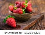 fresh organic strawberries | Shutterstock . vector #612934328