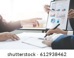 Small photo of Business executives meeting working with new project.discussion and analysis data, charts and graph presentation.