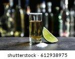golden tequila shot with juicy... | Shutterstock . vector #612938975