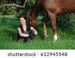 woman and horse resting at the... | Shutterstock . vector #612945548