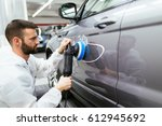 car detailing   hands with... | Shutterstock . vector #612945692