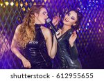 beauty girls with a microphone... | Shutterstock . vector #612955655