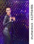 beautiful stylish girl in shiny ...   Shutterstock . vector #612956486