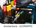 tattoo ink poured into small... | Shutterstock . vector #612984992