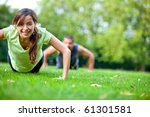 Fit people doing push-ups at the park - stock photo