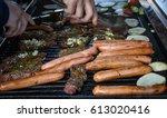 friends making barbecue outdoor ...   Shutterstock . vector #613020416