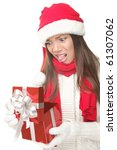 Christmas Gift - woman opening gift disappointed and unhappy, Young woman in Santa hat. Funny cute photo of Asian / Caucasian woman isolated on white background. - stock photo