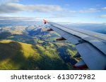 Airplane Flying Over Mountain...