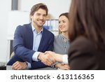 smiling young couple shaking... | Shutterstock . vector #613116365