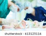 neonatal resuscitation. doctor... | Shutterstock . vector #613125116