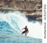 surfer on the wave  catches a...   Shutterstock . vector #613127102