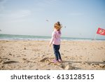 little girl playing with sand... | Shutterstock . vector #613128515