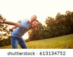 father piggyback his little son ... | Shutterstock . vector #613134752