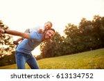 father piggyback his little son ... | Shutterstock . vector #613134752