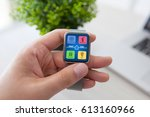 man hand holding watch with app ... | Shutterstock . vector #613160966
