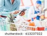 woman doing grocery shopping at ... | Shutterstock . vector #613237322