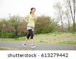 running asian woman   Shutterstock . vector #613279442