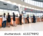 blurred customer transaction in ... | Shutterstock . vector #613279892