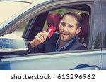 happy smiling man sitting... | Shutterstock . vector #613296962