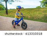 a cute little boy riding a... | Shutterstock . vector #613310318