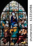 Small photo of TERVUREN, BELGIUM - MARCH 13, 2017: Stained Glass in the Church of Tervuren, Belgium, depicting Mary and the Apostles at Pentecost
