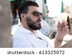 bearded man smoking. black and... | Shutterstock . vector #613325072