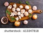 fresh champignon mushrooms with ...   Shutterstock . vector #613347818
