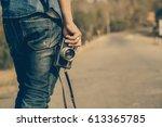 man photographer holding a... | Shutterstock . vector #613365785