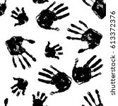 black handprints on white... | Shutterstock .eps vector #613372376