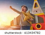 child in astronaut costume with ... | Shutterstock . vector #613434782