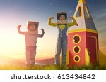 children in astronauts costumes ... | Shutterstock . vector #613434842