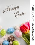 painted easter eggs and bouquet ... | Shutterstock . vector #613484852