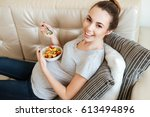 happy pregnant young woman... | Shutterstock . vector #613494896