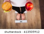 diet. woman measuring body... | Shutterstock . vector #613505912