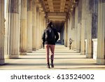 backpacker walking through the... | Shutterstock . vector #613524002