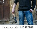 street hooligan is holding a... | Shutterstock . vector #613529702