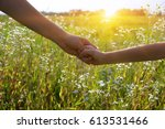 hands of holding each other in... | Shutterstock . vector #613531466