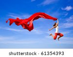 Beautiful Young Woman Jumping...