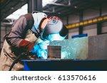 industrial welder with torch... | Shutterstock . vector #613570616