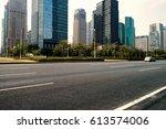 empty asphalt road of a modern... | Shutterstock . vector #613574006