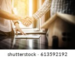 signing of a real estate... | Shutterstock . vector #613592192