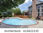 swimming pool in back of luxury ... | Shutterstock . vector #613622132