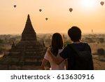 couple traveler looking at... | Shutterstock . vector #613630916
